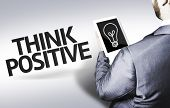 Business man with the text Think Positive in a concept image