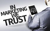 Business man with the text In Marketing We Trust in a concept image