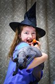 Teenage Girl Dressed In Witch Costume