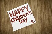Happy Childrens Day on Paper Note on texture background