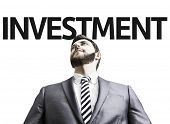 Business man with the text Investment in a concept image