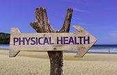 Physical Health wooden sign with a beach on background