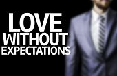 foto of revelation  - Business man with the text Love Without Expectations in a concept image - JPG