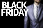 stock photo of friday  - Business man with the text Happy Black Friday in a concept image - JPG
