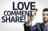 Business man pointing to transparent board with text: Love, Comment, Share!