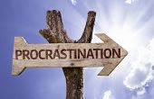 Procrastination wooden sign on a beautiful day