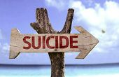Suicide wooden sign with a beach on background
