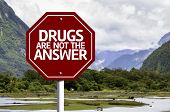 Drugs Are Not The Answer written on red road sign with landscape background