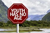 Youth Has No Age written on red road sign with landscape background