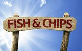 Fish & Chips wooden sign on a summer day