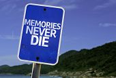 Memories Never Die sign with a beach on background