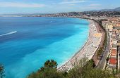 NICE, FRANCE - JULY 16 2014 - Luxury resort of French riviera. Beautiful panorama city and public beach of Nice in France. Summer day. Famous place of Nice.Cote d'Azur