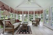 stock photo of screen-porch  - Sun room in modern home with wicker furniture - JPG