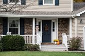 Front Porch Of Resedential Home With Autumn Decorations