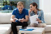 Couple Analyzing Unpaid Bills