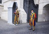 VATICAN CITY, ITALY - SEPTEMBER 23, 2014: Swiss Guard posted at St. Peter's Basilica, Vatican City.