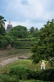 picture of jagannath  - An old temple pond with the famous temple of Jagannatha in the background in Orissa - JPG