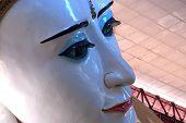 Close Up Sweet Eye White Reclining Buddha In Myanmar.