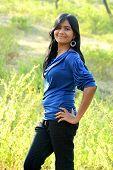 Portrait of teenage girl standing in outdoors