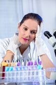 Young scientist woman working at the laboratory