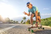 stock photo of sportive  - Sportive cool an on a skateboard  - JPG