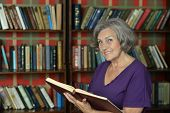 Beautiful elderly woman with book
