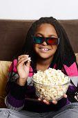 child eating popcorn watching 3d movie