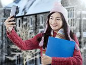 Sweet Student With Winter Clothes Taking Picture