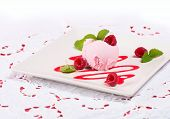 Pink Ice Cream Scoop With Sauce And Berries On White Cloth