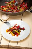 Fried Chili Pepper And Vegetable On A Wok Pan