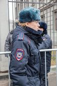 Samara, Russia - November 7, 2014: Woman Police Officer From Russia In Winter Uniform