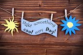 Light Blue Lable Saying Make Something Cool Every Day