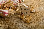stock photo of love bite  - Cheesy bites with seeds wine in wicker basket nice gift - JPG