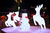 Illuminated snowman with christmas deers