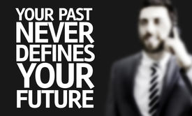 stock photo of past future  - Business man with the text Your Past Never Defines Your Future in a concept image - JPG