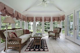 image of screen-porch  - Sun room in modern home with wicker furniture - JPG