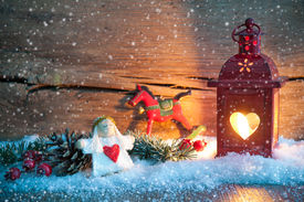 stock photo of christmas angel  - Christmas background with burning lantern in the snow - JPG