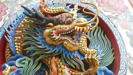 image of swagger  - Dragon swagger a carved wooden dragon - JPG