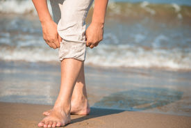 image of wet pants  - barefoot male tuck pants not to wet - JPG
