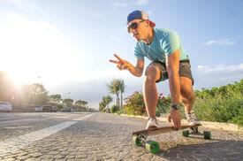 foto of skateboard  - Sportive cool an on a skateboard  - JPG