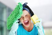stock photo of scream  - Tired frustrated and exhausted cleaning woman screaming - JPG