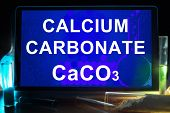 stock photo of formulas  - Tablet with chemical formula of  calcium carbonate - JPG