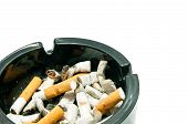 stock photo of butts  - butts in black ashtray on white background - JPG