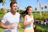Постер, плакат: Jogging couple of runners running together in park Active summer lifestyle two young adults jogger