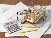 picture of rental agreement  - House with open interior on top of blueprints documents and mortgage calculations and builbers - JPG