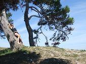 Girl and pine tree