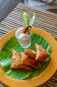 image of samosa  - meat and vegetable samosas served in a small restaurant - JPG