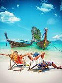 stock photo of couple sitting beach  - Couple of tourists on the beach in Thailand - JPG
