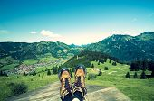 stock photo of wander  - mountain boots on alpine pasture with blue sky  - JPG