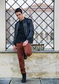 stock photo of turin  - Handsome young man outside historical building in European city  - JPG
